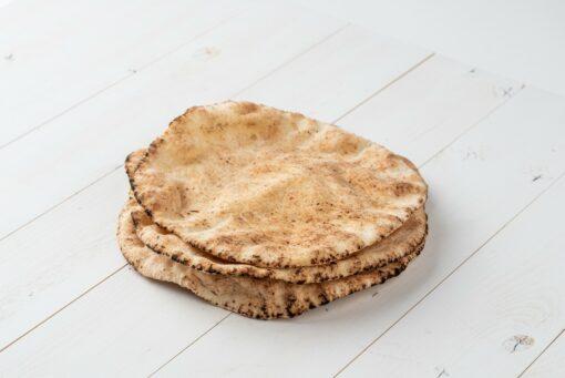 Alternative Plain Pita Bread on White Wooden Board