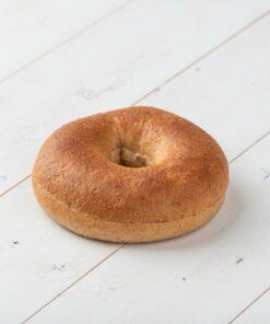 Alternative Wheat Bagel on white wood board