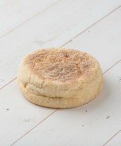Original English Muffins on a white wood board