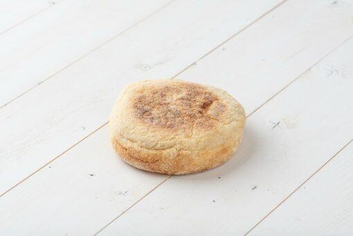 Sourdough English Muffins on a white wood board